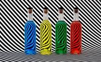 عکس بطری های رنگس زیبا با زمینه پوست گورخر آبی سبز قرمز زرد